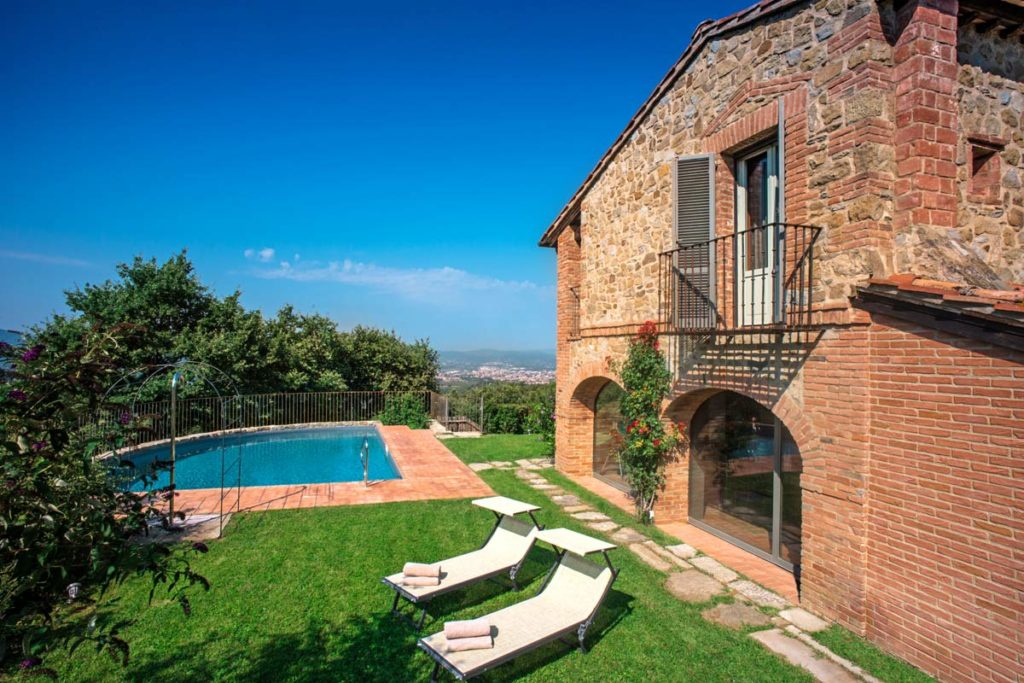 Outdoor pool in a Tuscan villa